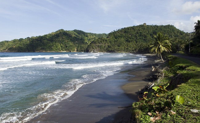 The most beautiful beaches with black sand in the world for Black sand beach caribbean